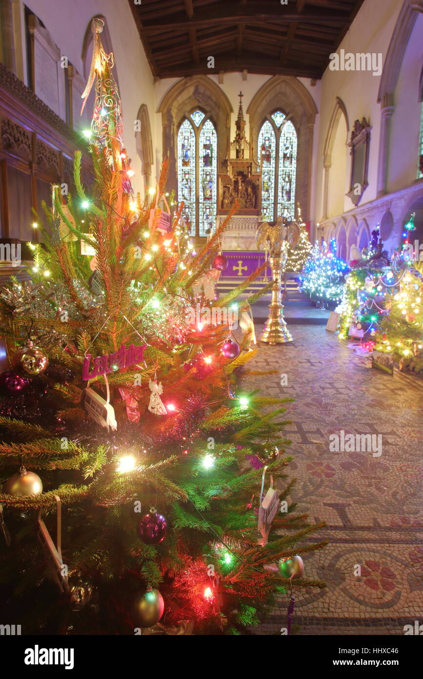 83182925a Festive decorations at an annual Christmas tree festival in a beautiful  English church in the Peak District National Park