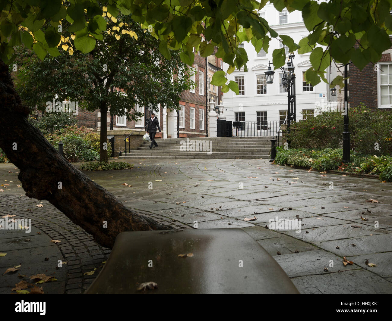 Tranquil scene in the City of London showing Middle Temple with its stone steps and overhung with trees - Stock Image