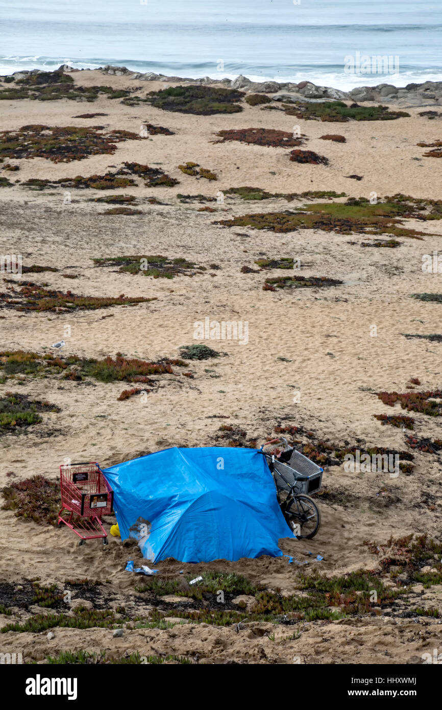 Homeless tent living on the beach, Monterey Bay, California, USA - Stock Image