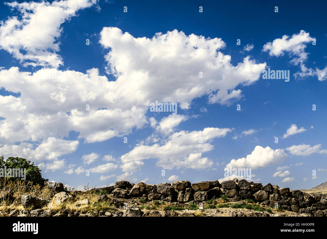 Increasing incoming streams rain clouds on sunny autumn sky - Stock Image