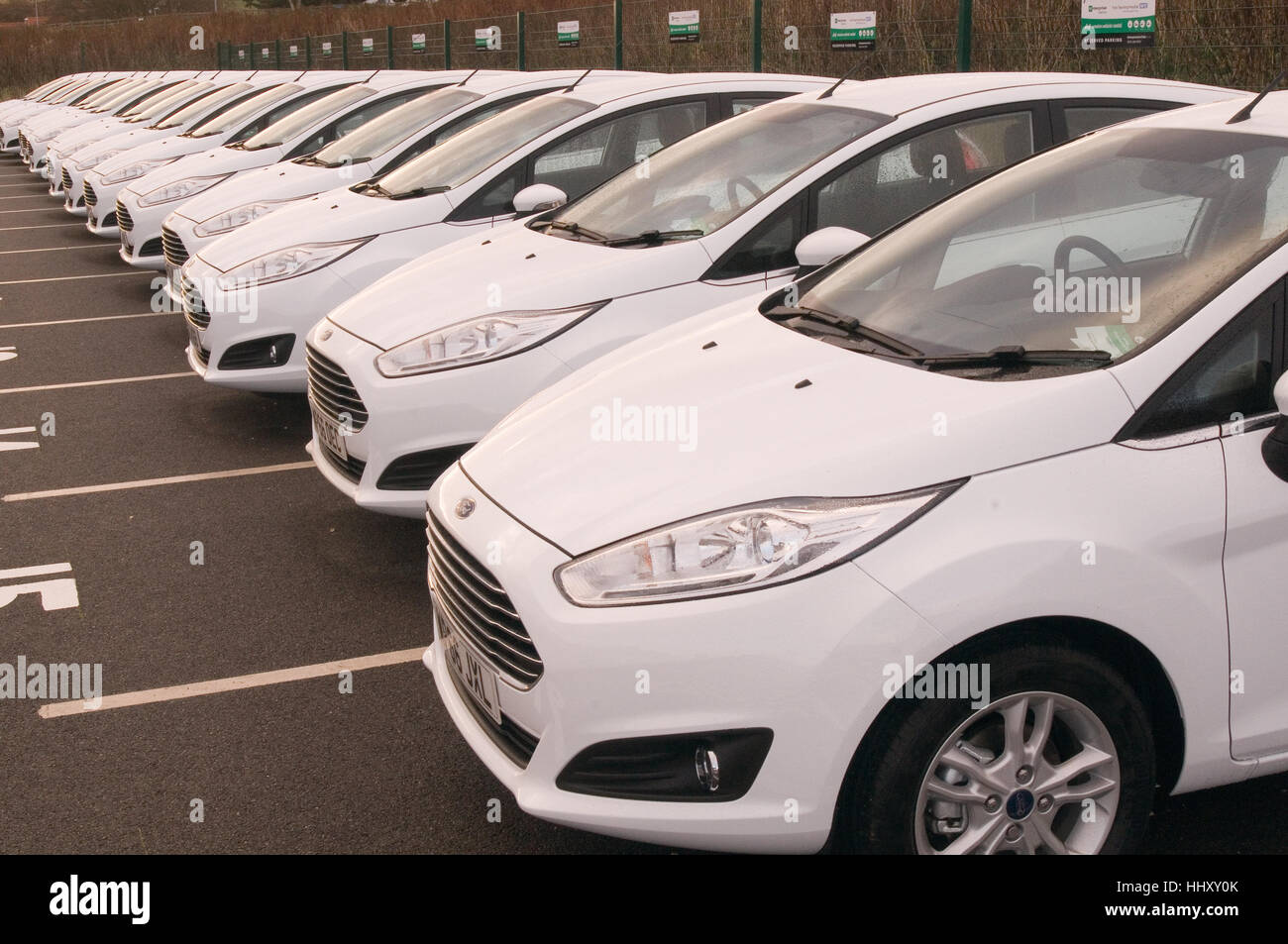rental car cars rented rent companies company new ford fiesta fiestas - Stock Image
