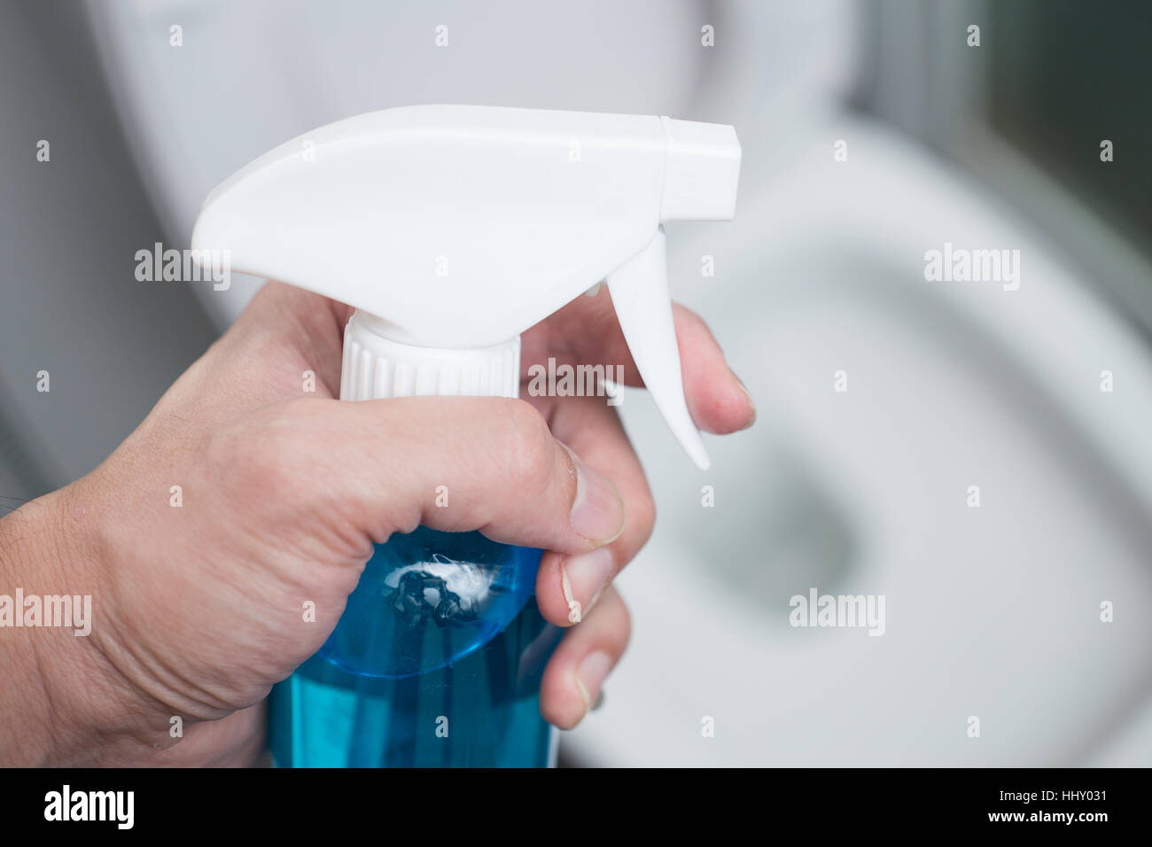 Hand spray cleaner with clean Toilet Seats or Bathroom Background ...