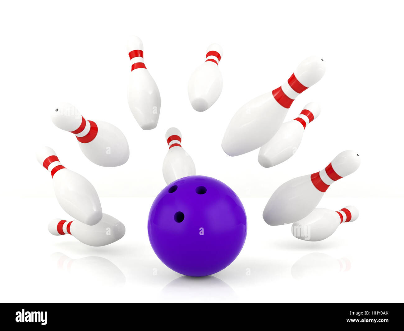 Ball crashing into the bowling pins - Stock Image