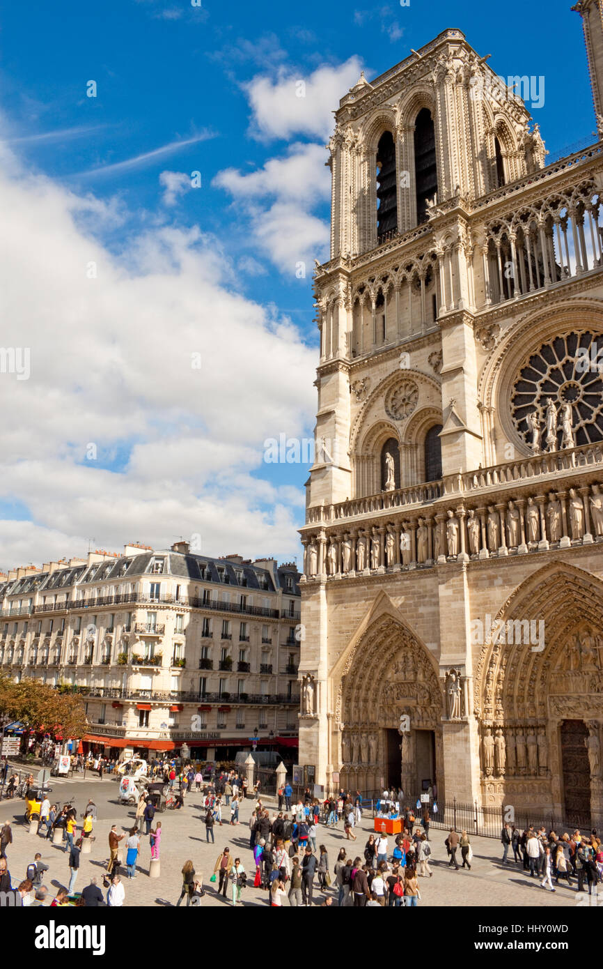 PARIS, FRANCE - SEPTEMBER 13, 2013:  Tourists walking in front of Notre Dame de Paris cathedral - one of the main - Stock Image
