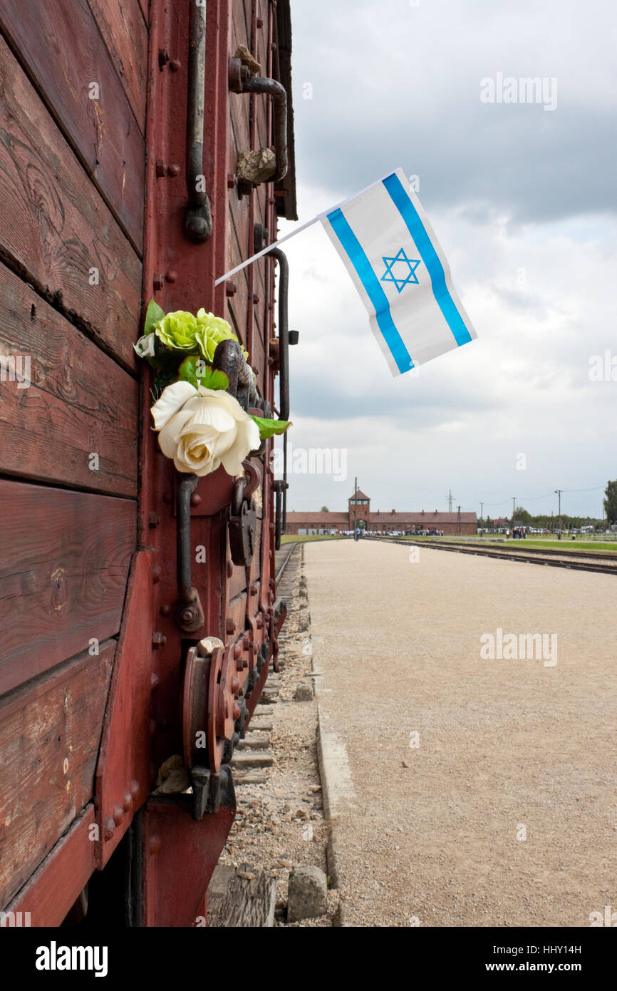OSWIECIM, POLAND - SEPTEMBER 6, 2012: Israel flag on a deportation train wagon commemorating the victims of nazi - Stock Image