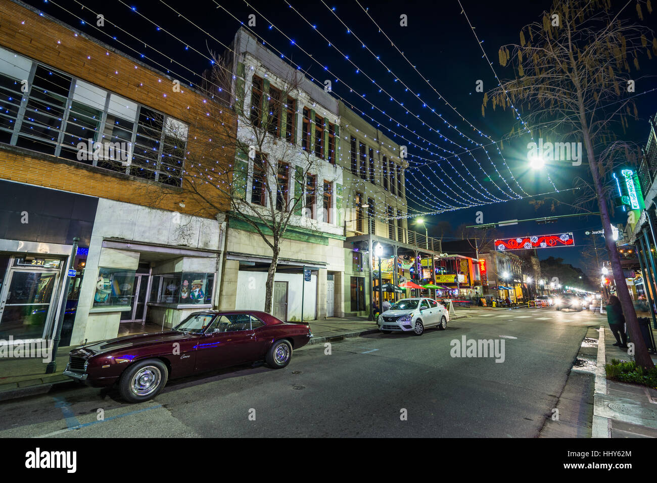 String Lights Hung Over Dauphin Street And Buildings In Downtown