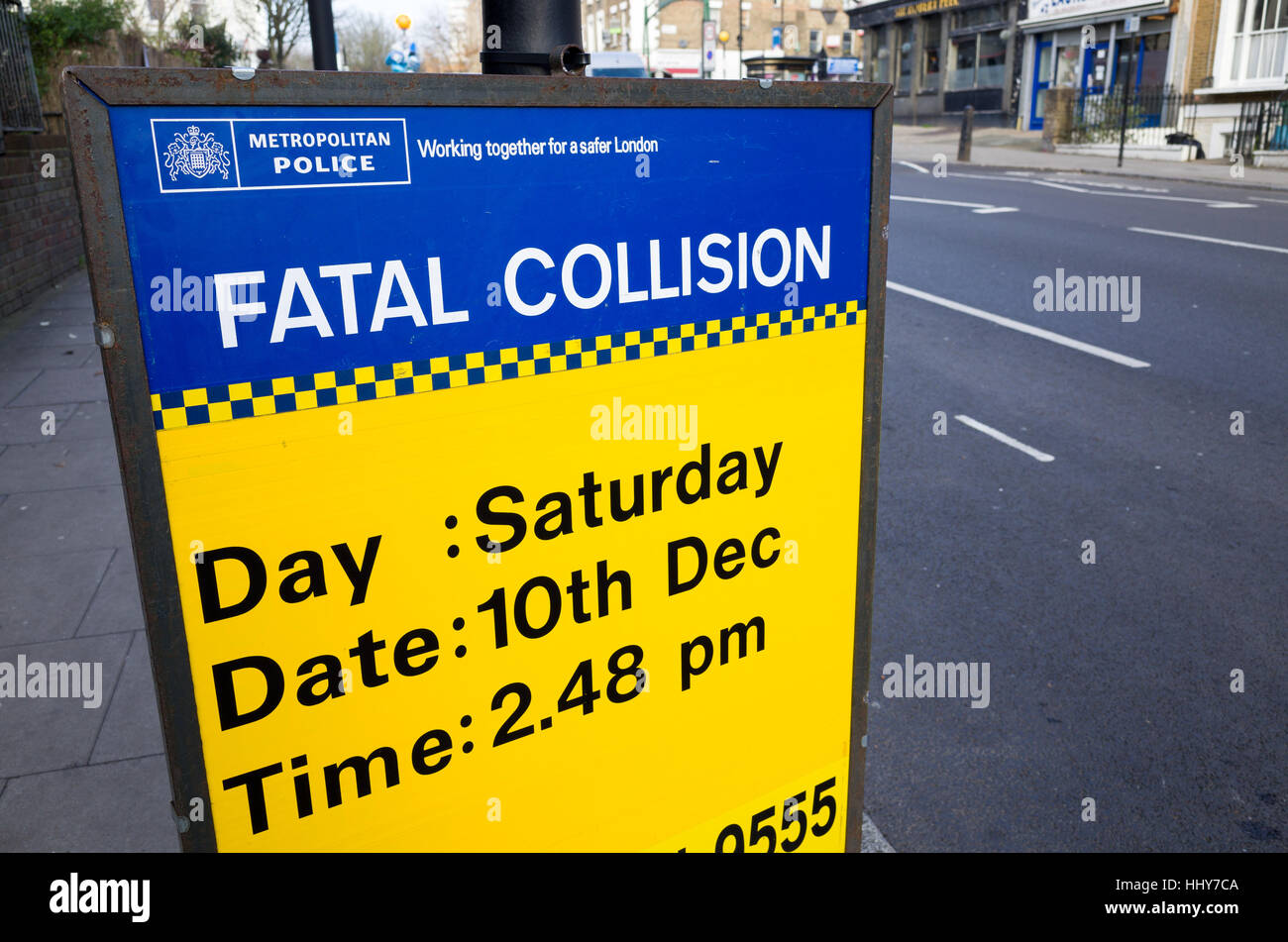Police Fatal Collision sign beside where a teenager was killed in a road traffic accident, London, England, UK - Stock Image