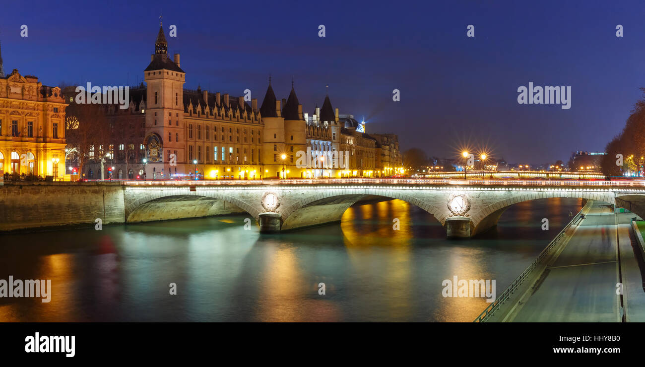 Panorama of Conciergerie at night, Paris, France - Stock Image