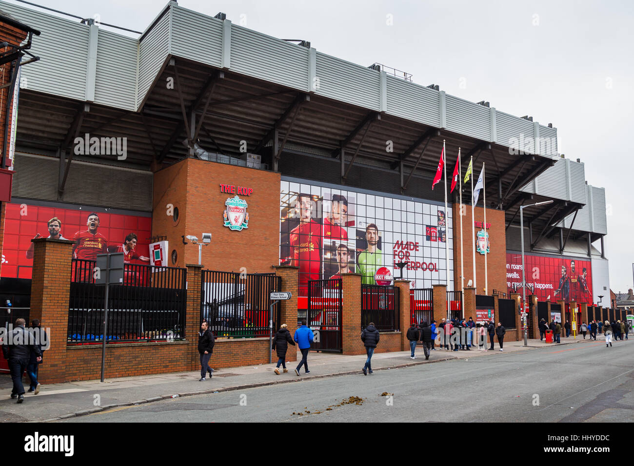 Walton Breck Road empties as the last few fans make their way into Anfield stadium as Liverpool host Swansea City - Stock Image