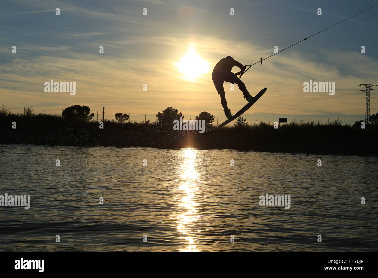 Sunset wakeboarding session in Alpipark. - Stock Image
