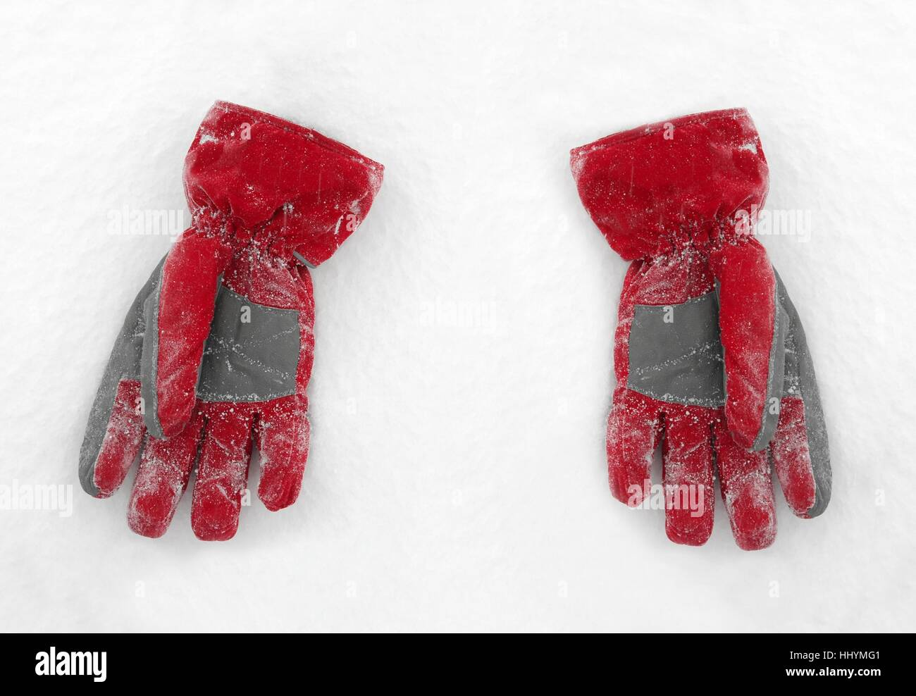 A pair of red glows on the snow - Stock Image
