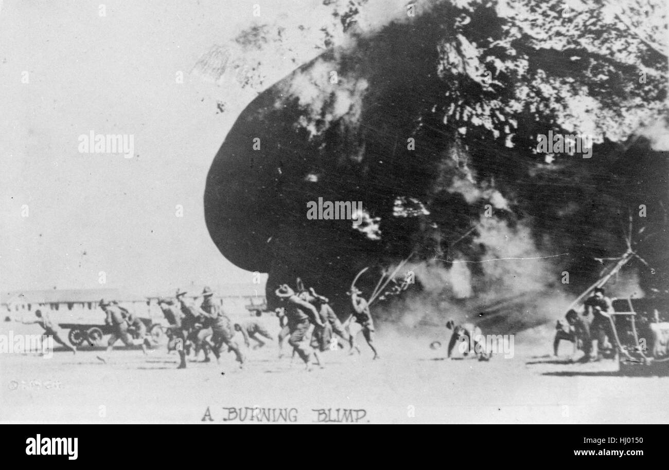 Antique c1917 photograph, Soldiers scramble for safety as a U.S. Army kite balloon explodes at Fort Sill, Oklahoma. - Stock Image