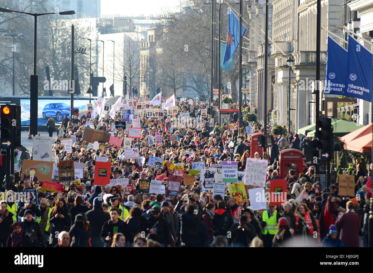 In London a Women's march against Donald Trump gathered outside the US Embassy before heading to a rally in - Stock Image
