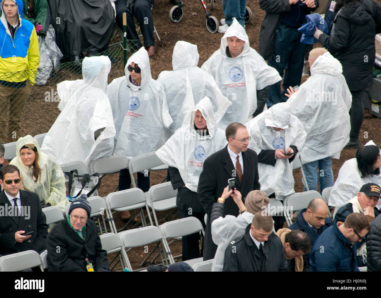 People wearing ponchos protect themselves from the rain prior to Donald J. Trump being sworn-in as the 45th President - Stock Image