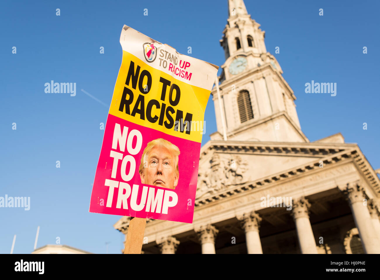 London, UK - 21 January 2017. Protest sign from Stand up to racism against Donald Trump. Thousands of protesters - Stock Image
