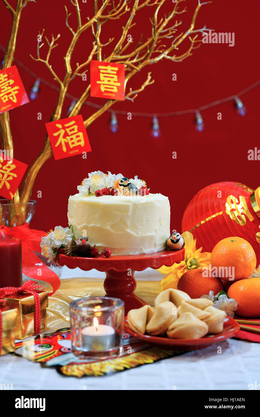 chinese new year party table in red and gold theme with food and traditional decorations