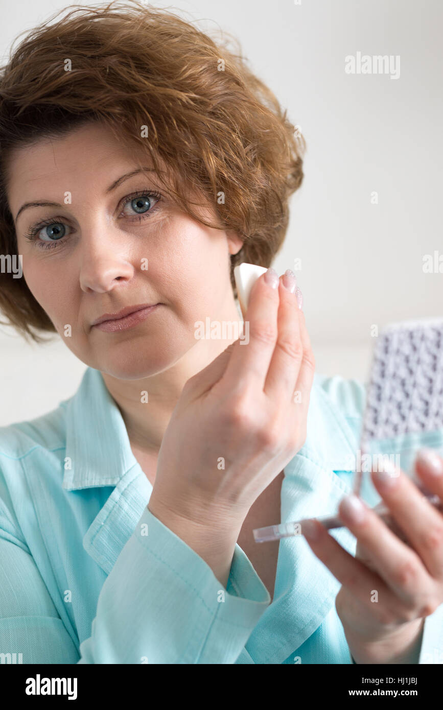 Woman puts makeup on face of yourself stock photo 131572774 alamy woman puts makeup on face of yourself solutioingenieria Image collections