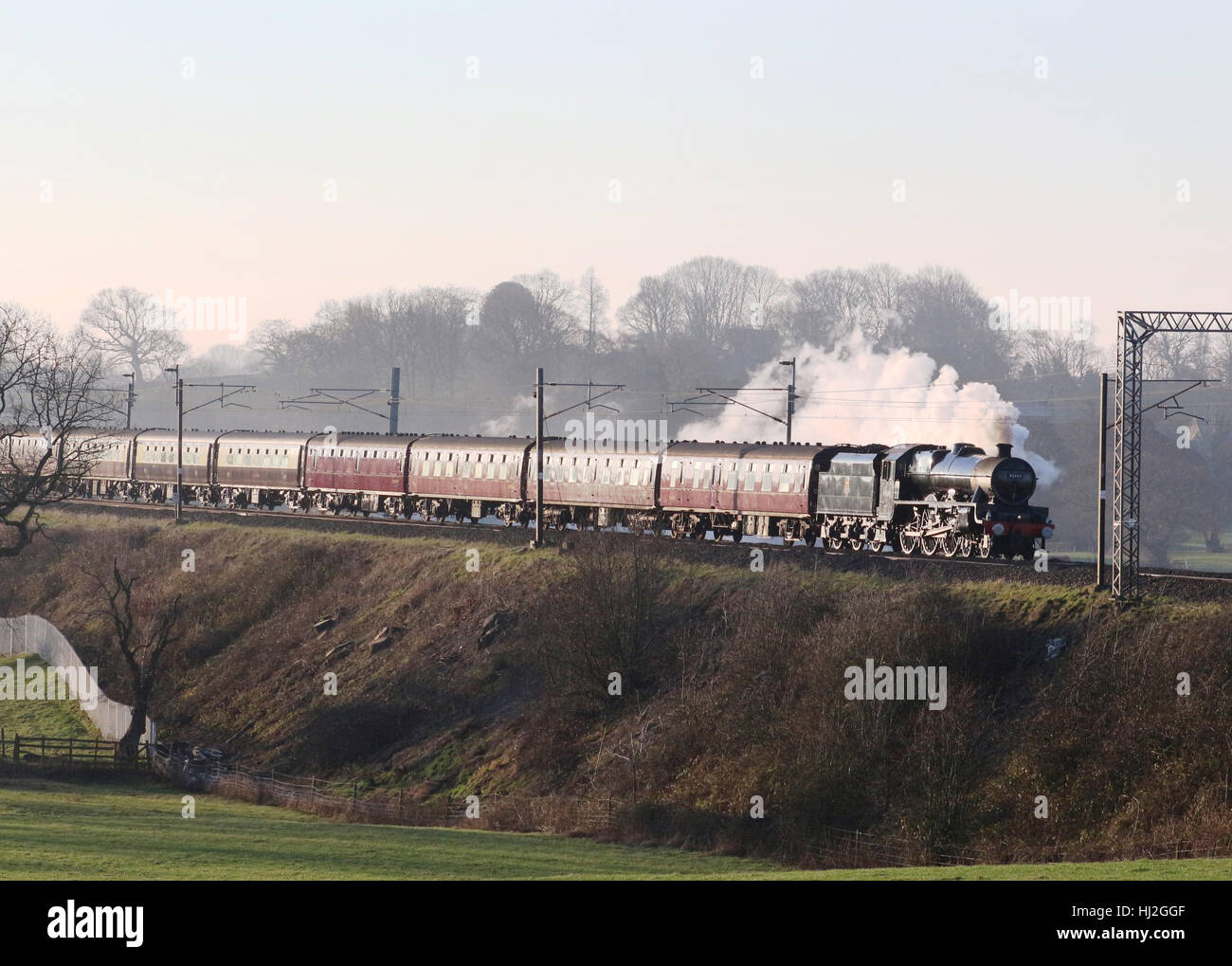 Preserved steam train Leander working Winter Cumbrian Mountain Express passes Bay Horse on the West Coast Main Line - Stock Image