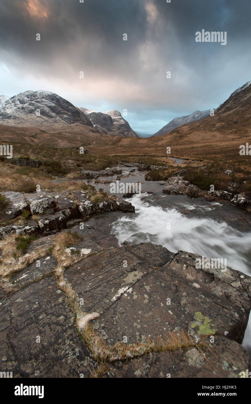Area of Glencoe, Scotland. Picturesque dramatic view of Glencoe with the River Coe in the foreground. Stock Photo
