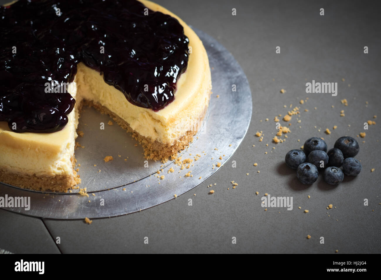 piece of freshness delicious blueberry cheese cake on plate is sweet baked bakery dessert,selective focus. Stock Photo