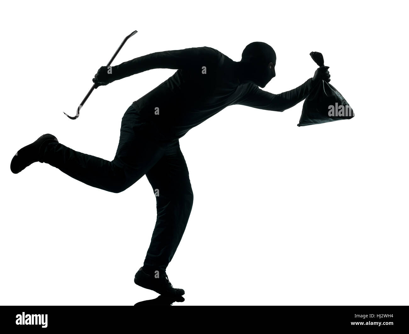 thief criminal running in silhouette studio isolated on