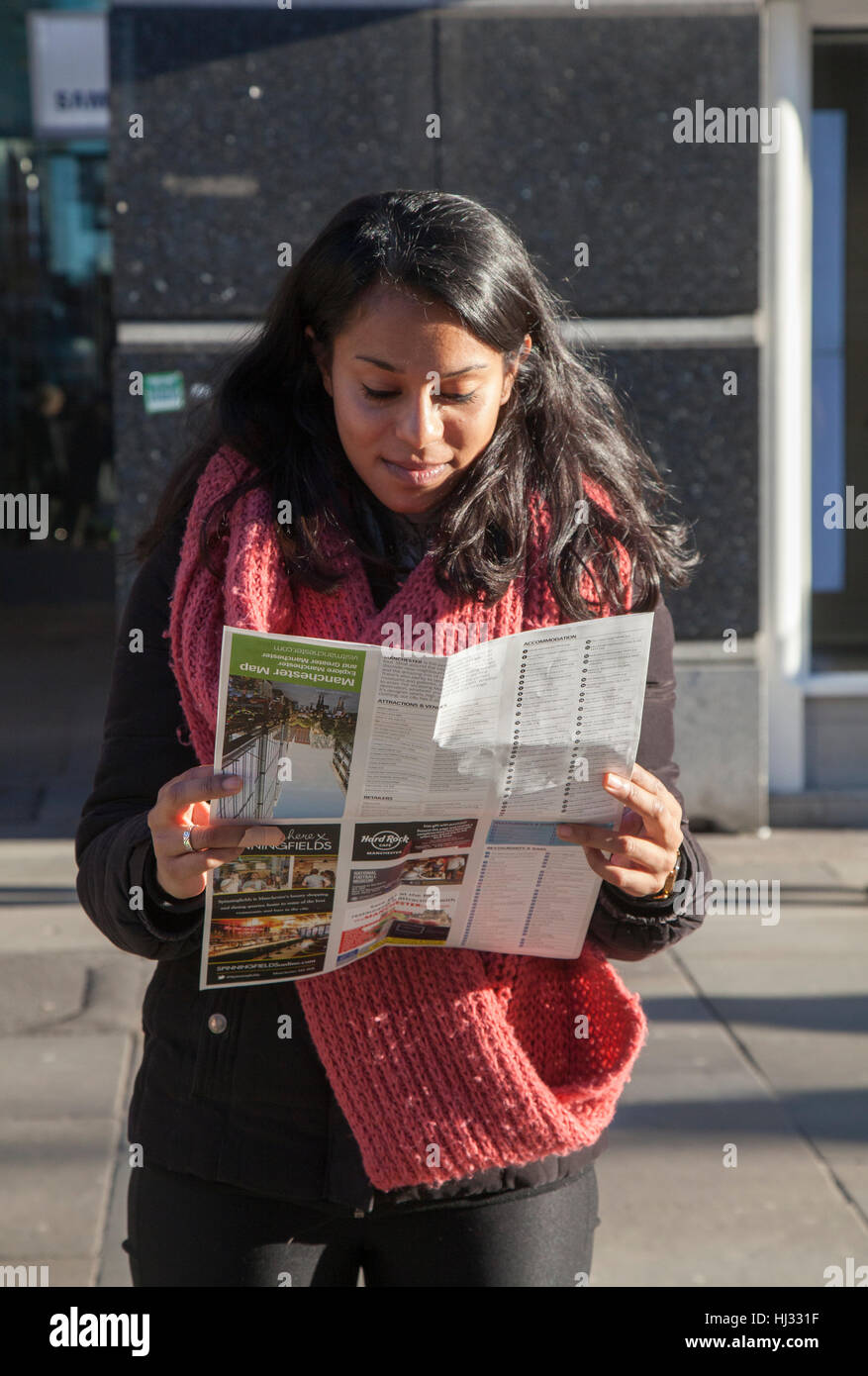 Foreign tourist reading map in Piccadilly, Manchester, UK - Stock Image