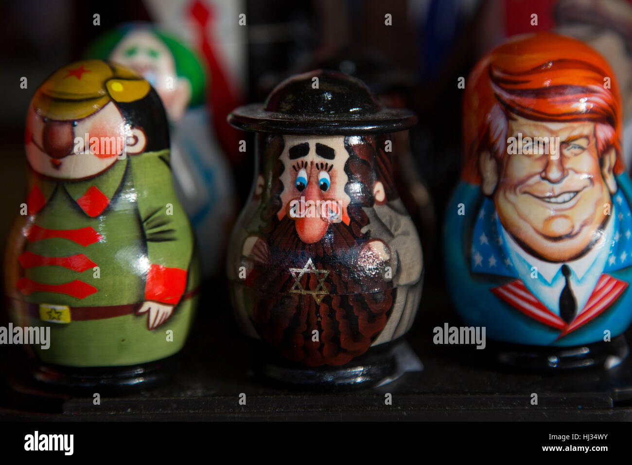 Russian traditional toys - Matryoshka with a portrait of Donald Trump in souvenir kiosk on the Red square in Moscow, - Stock Image
