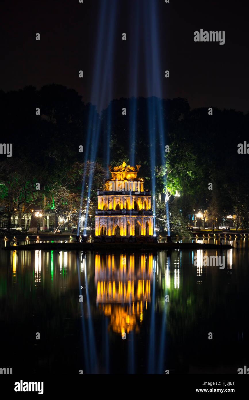Pagoda reflected on water and light shafts, Hoan Kiem Lake, Hanoi, Vietnam - Stock Image