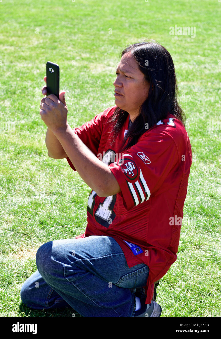 Navaho Native American Indian man at Prescott Inter-tribal Pow Wow Arizona taking photo with cell phone - Stock Image