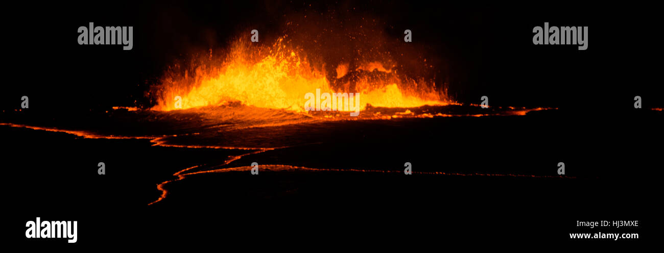 Active lava exploding inside the Halemaumau Crater at night, Kilauea Volcano, Volcanoes National Park, Hawaii, USA - Stock Image