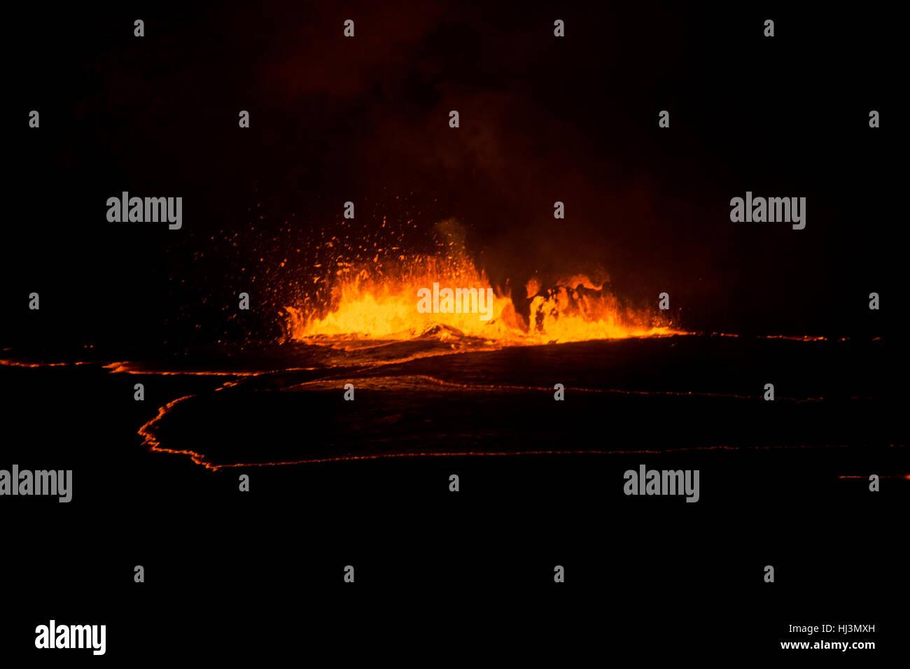 Active lava exploding inside the Halemaumau Crater at night, Kilauea Volcano, Volcanoes National Park, Hawaii, USA - Stock Image