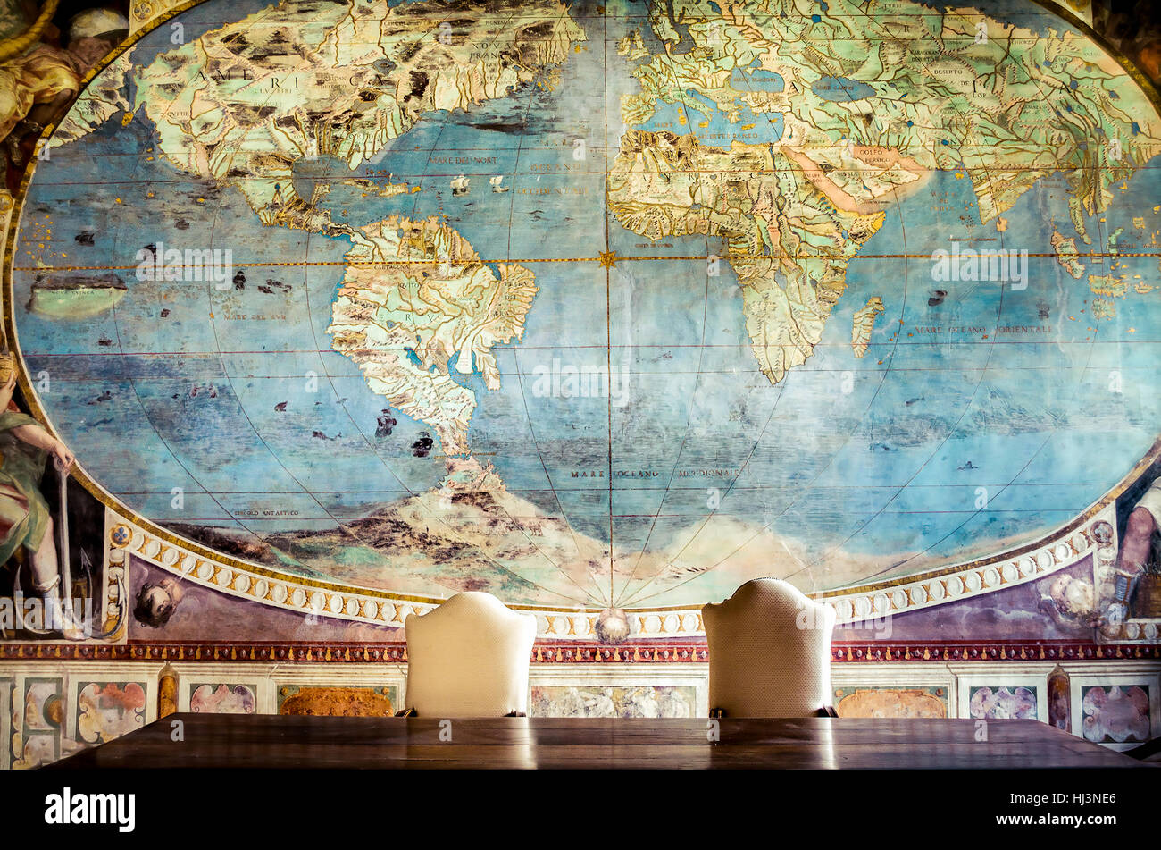 freemasonry controlling the world conspiracy Caprarola a big table with two empty chair and  an old world map on - Stock Image