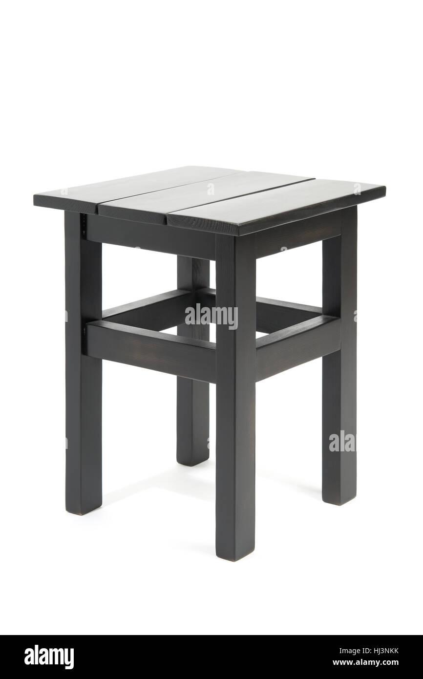 Black wooden stool isolated on white background - Stock Image