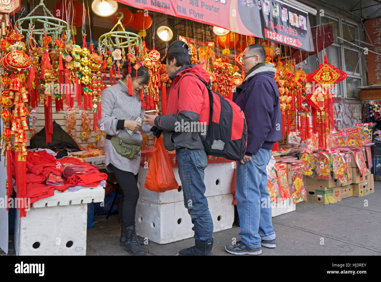 Asian American Men Buying Good Luck Symbols For Chinese New Year