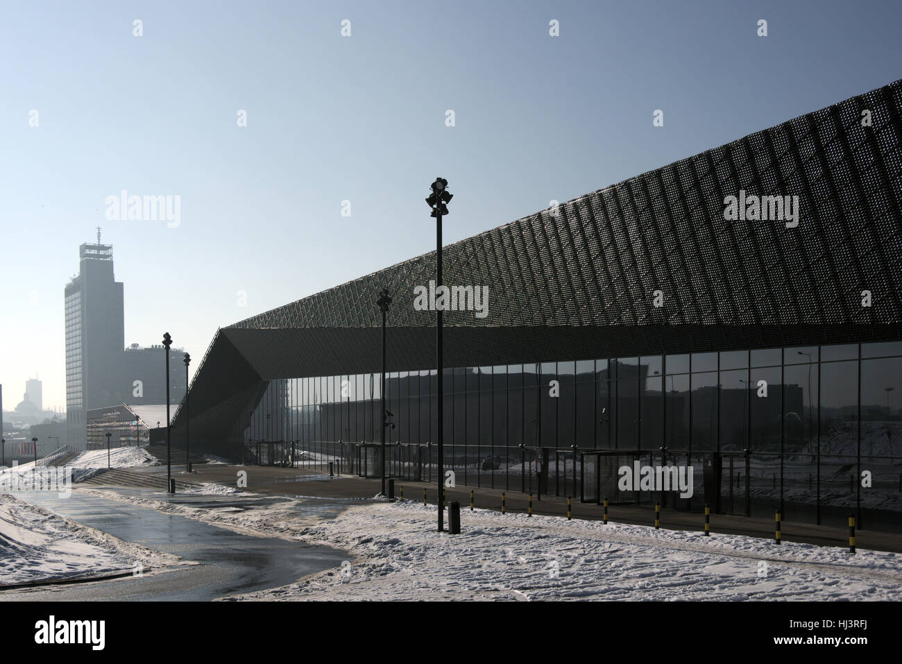 Modern building of  International Conference Centre in Katowice in the background highest building,silhouette cathedral - Stock Image
