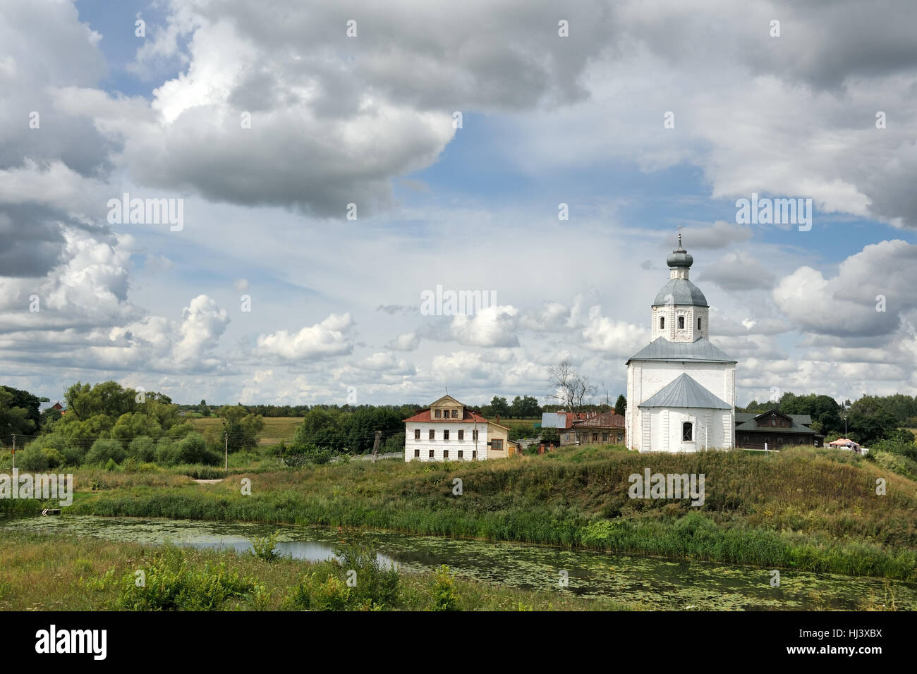 White Clouds Around the Church of Elijah the Prophet. Landscapes of Suzdal, Russia. - Stock Image