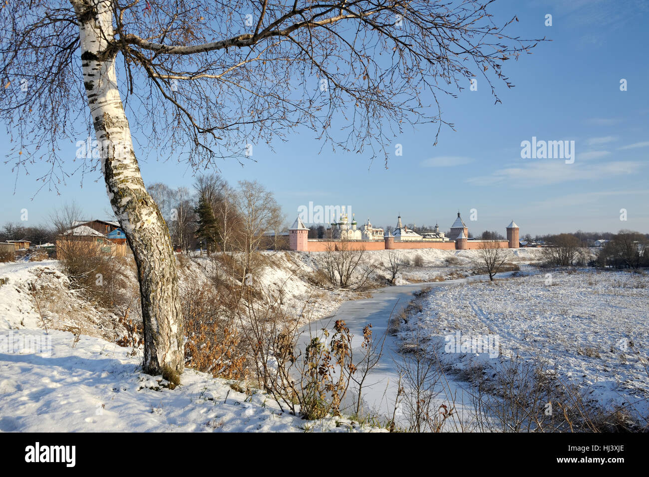 Overlooking St. Euthymius Monastery and Kamenka River at the Beginning of Winter. Cityscapes of Suzdal, Russia. - Stock Image