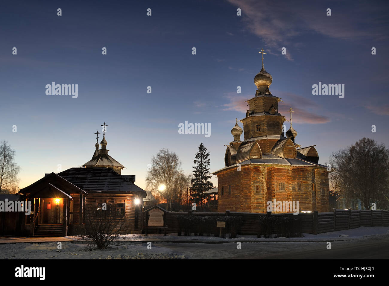 At the Entrance into Museum of Wooden Architecture at Winter Twilight. Suzdal, Russia - Stock Image