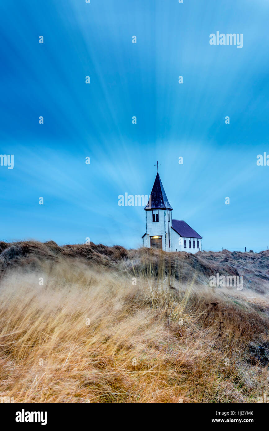 An old church in a remote countryside in Iceland during a rainy, stormy morning - Stock Image