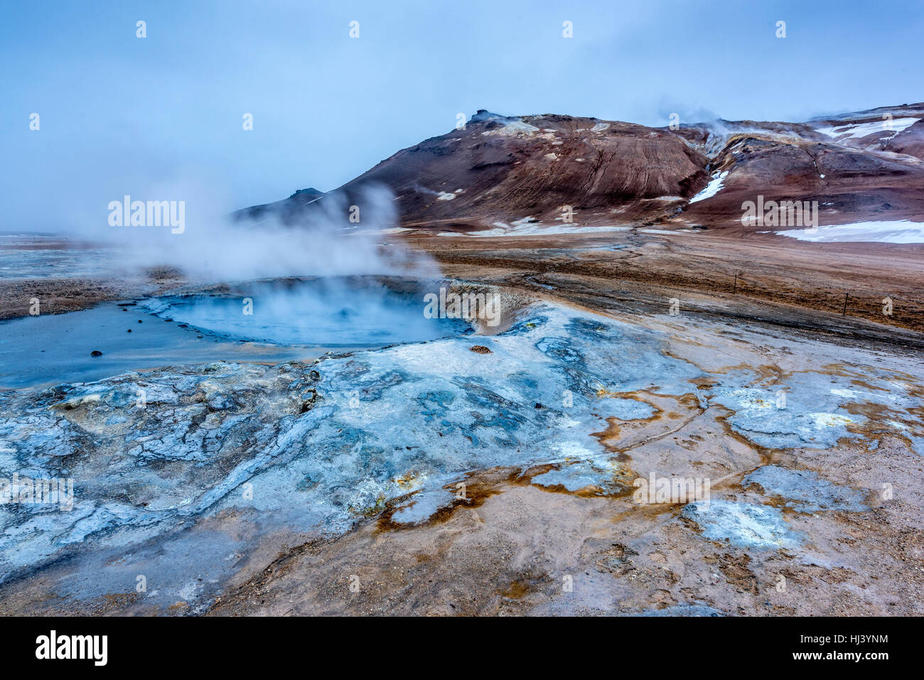 Natural steam rising from volcanic vents in the earth at Hverir in Iceland near Myvatn Lake - Stock Image