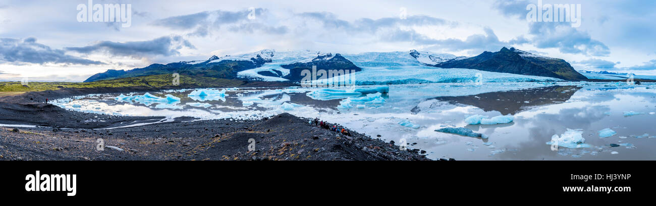 Panorama image of Iceland's Secret Lagoon.  The site is full of glaciers and icebergs surrounded by mountains - Stock Image