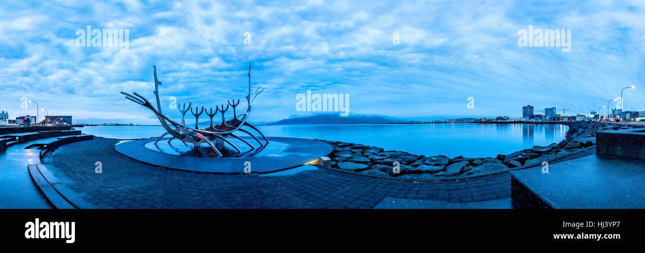 Solfar Sun Voyager metal Viking ship in Reykjavik, Iceland facing the harbor waterfront. - Stock Image