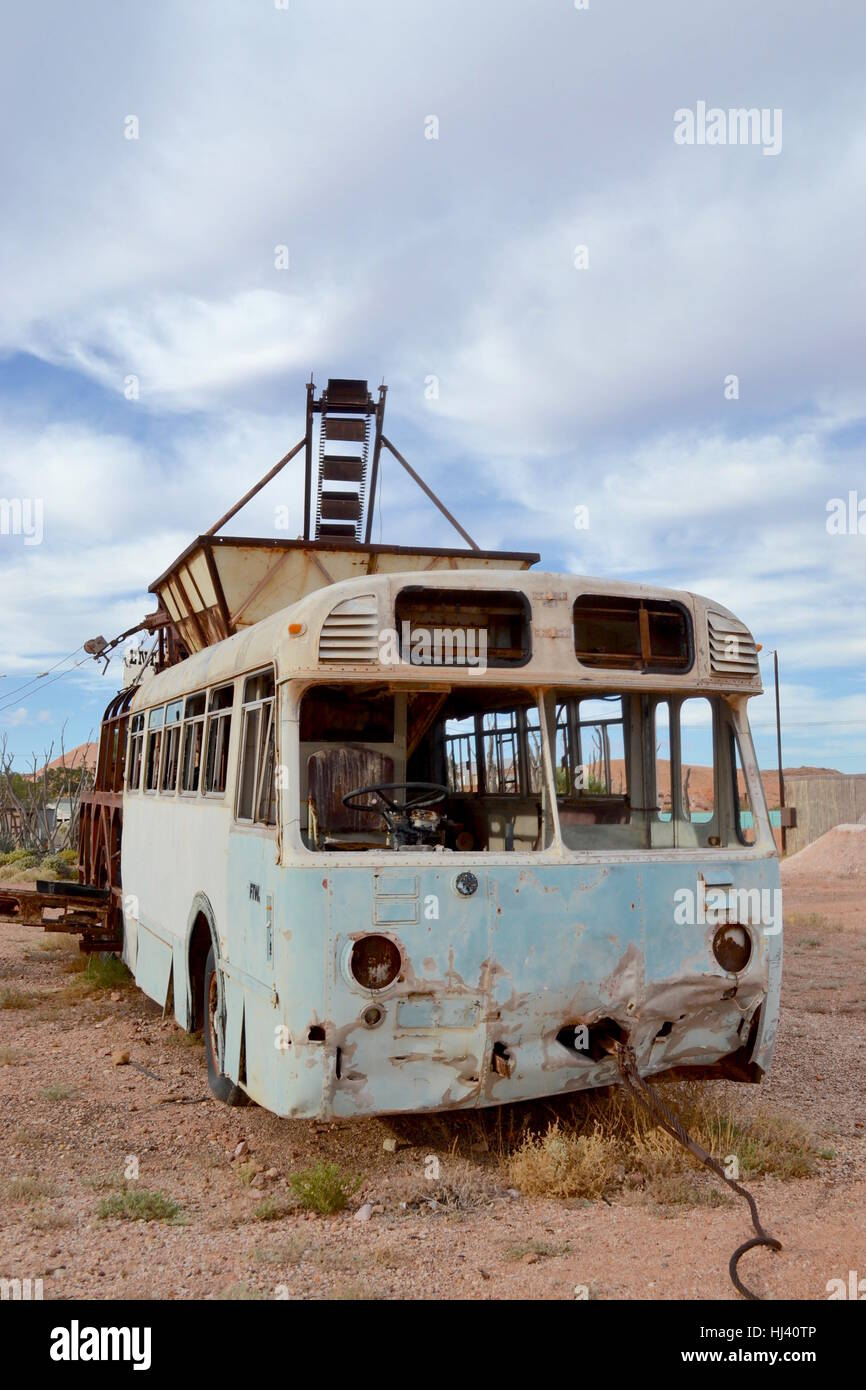 Discarded homemade opal mining equipment using rusty bus in Australian outback town of Coober Pedy -