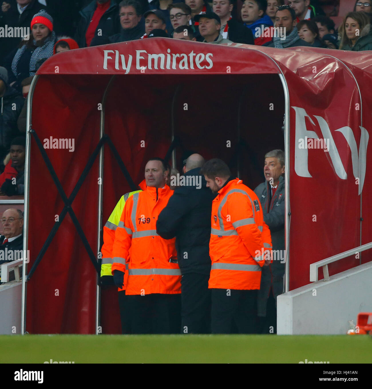Arsenal's Manager Arsene Wenger remonstrates with an official after being sent to the stand during the Premier League - Stock Image