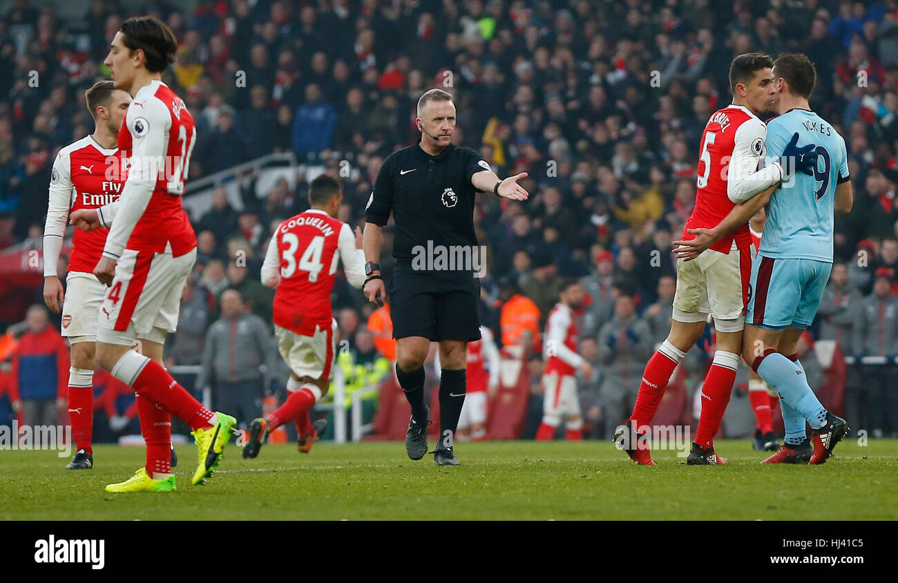 Referee Jon Moss awards Arsenal a penalty after Ben Mee of Burnley fouls Arsenal's Laurent Koscielny in added time - Stock Image