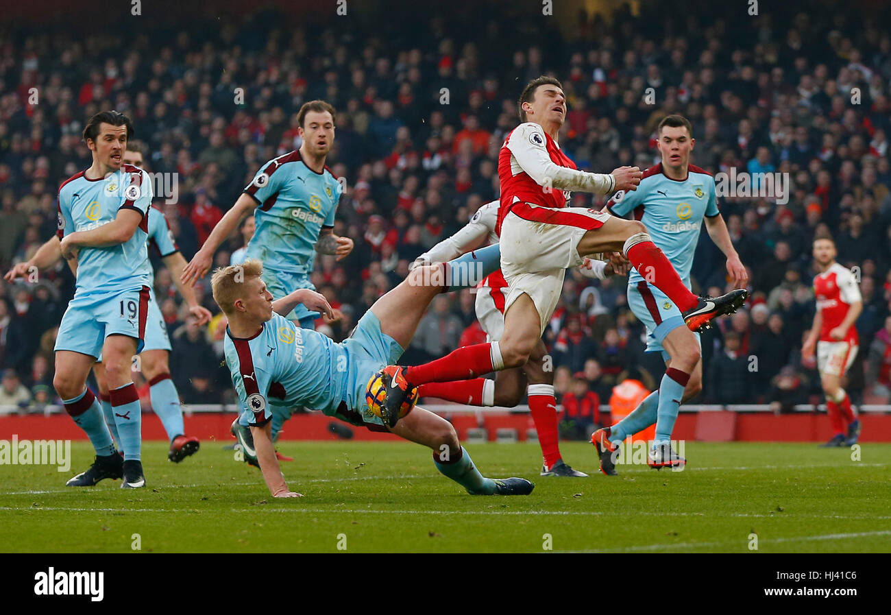 Ben Mee of Burnley fouls Arsenal's Laurent Koscielny for a penalty in added time during the Premier League match - Stock Image