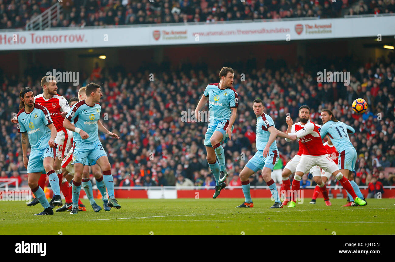 Arsenal's Shkodran Mustafi looks on as his header goes in during the Premier League match between Arsenal and Burnley - Stock Image