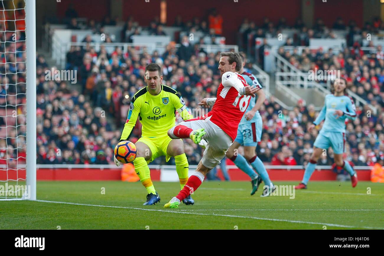 Arsenal's Nacho Monreal puts Thomas Heaton of Burnley under pressure during the Premier League match between Arsenal - Stock Image