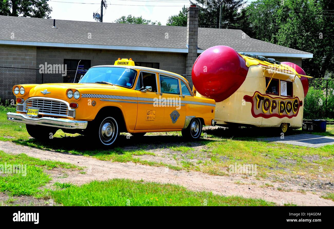 Middletown, Connecticut - July 9, 2013:  Vintage yellow NYC checker taxicab with hot dog food truck  * - Stock Image