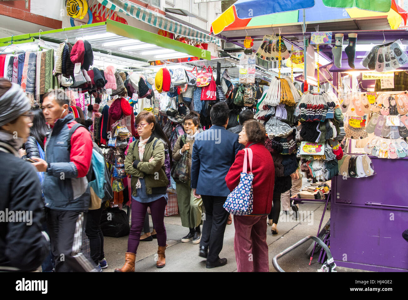 people in a popular market on the streets in Hong Kong - Stock Image